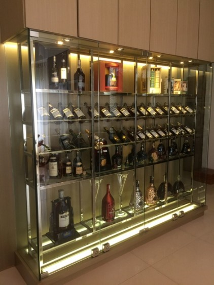 A lighted box enhance the dispaly in this wine cabinet